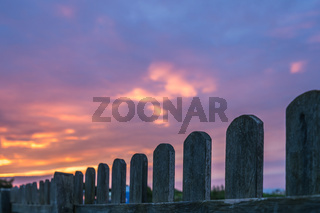 Wooden fence and sunset sky
