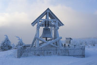 Peace bell on the summit of Fichtelberg with snow in winter