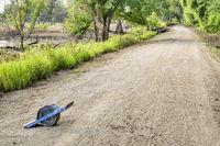 onewheel electric skateboard on a muddy bike trail