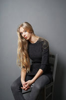 teenage girl slouching on chair