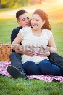 Hispanic Pregnant Young Couple Portrait Outdoors