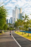 woman running in public park with city skyline in background, Panama city -