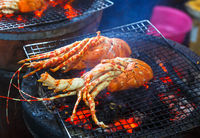 Lobsters are cooked on the grill