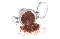 Brown flax seeds in glass airtight jar isolated on white background