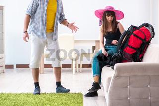 Young active pair preparing for honeymoon trip