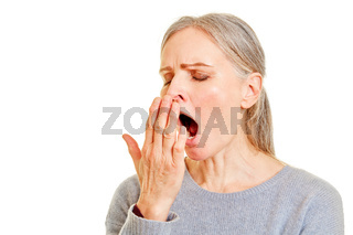 Müde Frau beim Gähnen halt Hand vor den Mund
