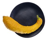 orange decorative gourd on a plate