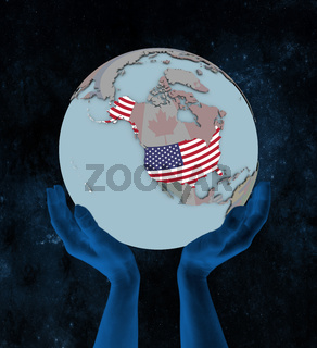 USA on political globe in hands