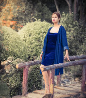 Beautiful woman on a bridge in the park