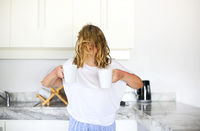Woman with two cups of coffee in morning