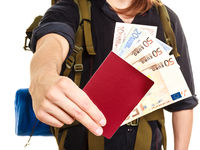 Tourist backpacker holding money and passport.