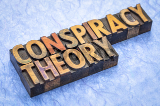 conspiracy theory text in wood type