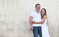 Portrait of happy couple posing by the old country house