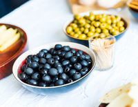 Black and green olives in bowls