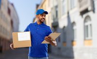 delivery man with parcel and clipboard in city
