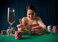 Young woman playing in the casino