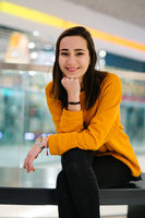 Young and happy woman is sitting in a mall