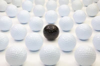 Pattern with white and black golf balls