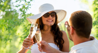 smiling couple drinking champagne on picnic