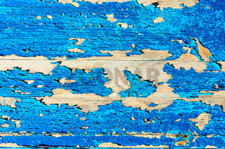 Old wooden texture with flaking blue paint