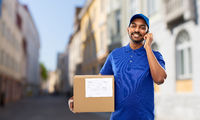 delivery man with smartphone and parcel in city