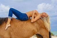 Implied Nude Blonde Model And Horse On A Caribbean Beach