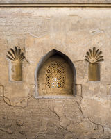 Perforated arched stucco window decorated with floral patterns, Outer wall of Mosque of Ibn Tulun, Medieval Cairo, Egypt