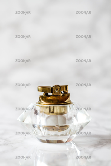 Vintage Glass Table Lighter on White Marble Background