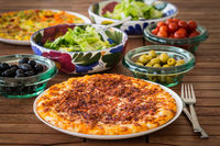 Spanish pizza with   Iberian ham and salat