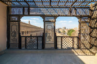 Passage surrounding the Mosque of Ibn Tulun framed by wooden window, Mashrabiya, Cairo, Egypt