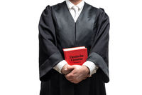 german lawyer with a robe and a book