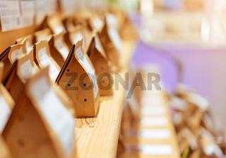 Brown paper food bag packages on wooden shelf