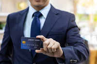 Businessman hold credit card