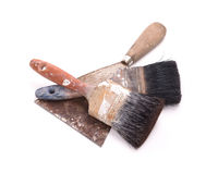 Old paintbrushes with a putty knife