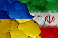 flags of Ukraine and Iran painted on cracked wall