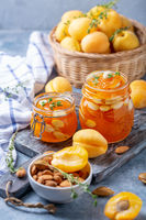 Homemade apricot jam with thyme and sweet almonds.