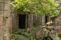 Pile of rocks beside two temple doorways