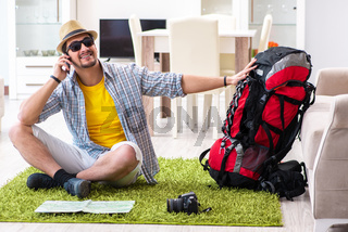 Man planning his travel with map
