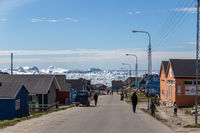 Colorful houses and icebergs in Ilulissat, Greenland