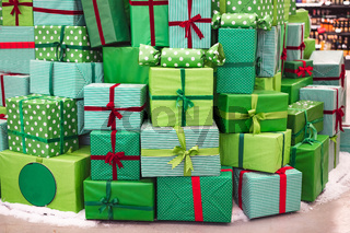 Photographs of many Christmas gifts from close perspective