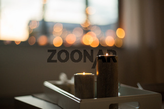 close up of candles on table at home