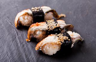 Unagi nigiri sushi set on the black slate