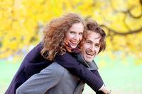 Couple having fun in autumn park