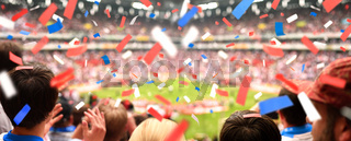 Fans im Stadion & Konfetti