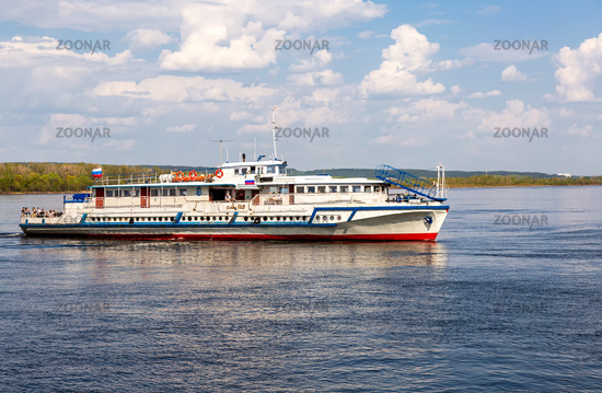 River cruise ship with passengers sailing on the Volga River