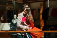 Couple hug in shopping mall