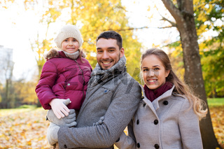 happy family walking at autumn park