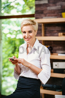 Modern business woman after meeting with business partners