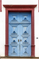 Ancient blue church door in Sabara city