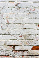 Old wall, cracked and dirty, bricks. White color vertical design background
